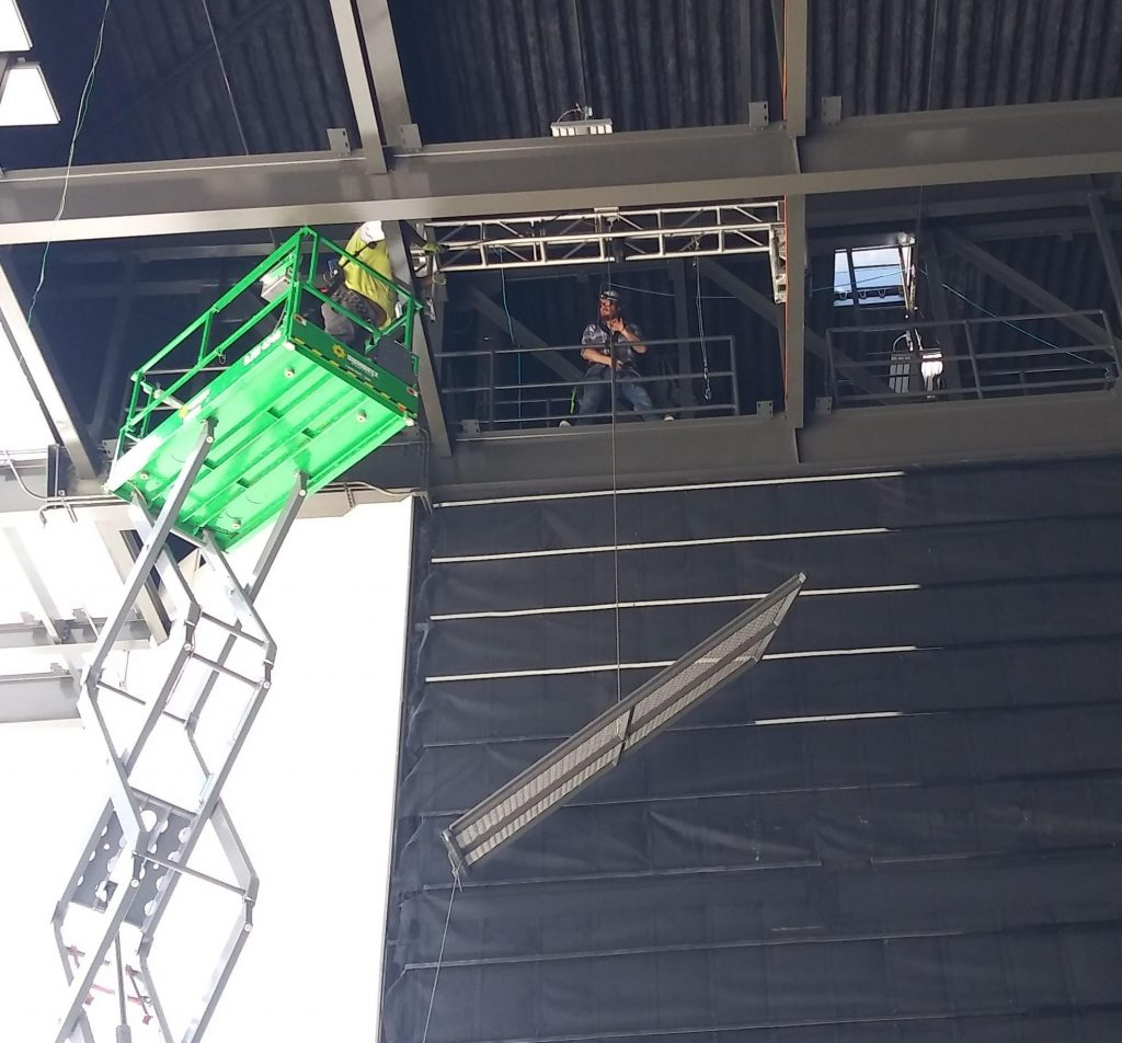 First SkyDeck panel getting installed above White River State Park's new permanent stage.