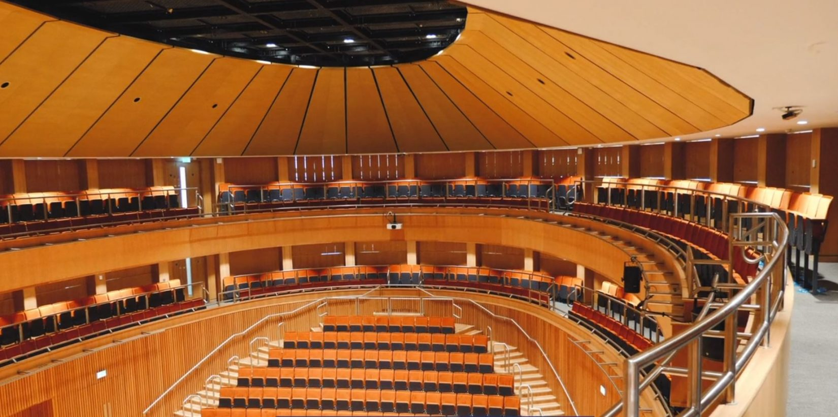 Interior of Olivier Hall at St. Edward's School in Oxford. The oval shaped hall features a 1060.25 ft2 SkyDeck tension wire grid.